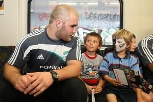 Ben Franks was one of 10 All Blacks on the train with Marist under-7's players yesterday. Photo / Greg Bowker