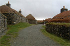 A village of restored blackhouses - sturdy stone dwellings topped with thatch and turf - on the Island of Lewis. Photo / Wikimedia Commons image by user Morrismaciver