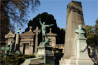 Sculptural headstones and trees make walking through Pere Lachaise Cemetery pleasant. Photo / Liz Light