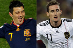 Spanish striker David Villa will be up against Germany's Miroslav Klose. Photos / AP