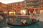 Gondoliers who drift down spruced-up canals at the Venetian Macau are friendlier than the real ones. Photo / Jim Eagles