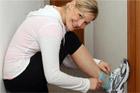 Lorna Wilkinson straps on weights. Photo / Herald on Sunday