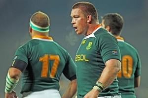 John Smit's versatility, determination and shrewd leadership skills have made him the cement holding the Springbok squad together. Photo / Getty Images
