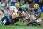 Matt Gillett of the Broncos forces his way to the try line during the round 19 NRL match between the Gold Coast Titans and the Brisbane Broncos. Photo / Getty Images