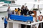 Moko's coffin is  taken on one last boat trip around Whakatane Bays. Photo / Christine Cornege