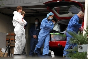 Police and forensic experts at Carmen Thomas' house. Photo / Janna Dixon