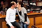 Owners of French restaurant La Cantine du Torchon Romain Cressant and Vanessa Chollet share a kiss at the bar. Photo / Babiche Martens