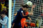 Spain's Sergio Ramos and Netherlands' Robin van Persie challenge for the ball during the World Cup final.