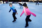Children enjoy ice skating on the ice rink at the Alpine Springs and Spa and Winter Park, Lake Tekapo. Photo / Sarah Ivey