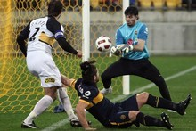Andrew Durante scores for the Phoenix against Boca Juniors on Friday night. Photo / Getty Images