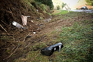 Wreckage and a teen's shoe left at the scene of a horror crash involving 12 young people from Rotorua. Photo / Jason Dorday