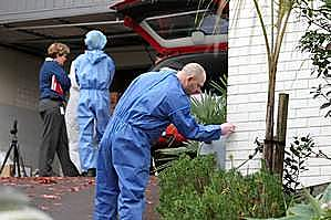 Police and forensic officers work at the Remuera home of missing woman Carmen Thomas. Photo / Janna Dixon