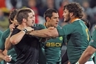 Richie McCaw of the All Blacks fights with Danie Rossouw of the Springboks. Photo / Getty Images