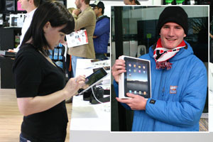 A woman tests the iPad in Auckland this morning. Inset: A triumphant Marty Hehewerth shows off his iPad. Photos / nzherald.co.nz