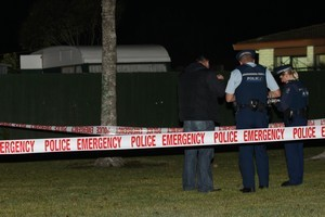 The scene where a man was shot by police in west Auckland on Sunday night. Photo / Natalie Slade