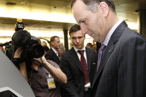 Prime Minister John Key used his ePassport reader at the launch of SmartGate. Photo / Sarah Ivey