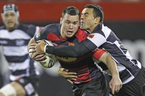 Ryan Crotty of Canterbury is tackled by Kahn Fotuali'i of Hawkes Bay. Photo / Getty Images