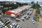 Elevated view of 3 Moana Ave retail block of eight shops anchored by a Mad Butcher shop. Photo / Supplied