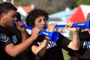 Whakatane Intermediate students Kagen Ohlson, 13, and Teonui Moore, 12, find the noisy trumpet a blast. Photo / APN