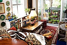 Inside the cosy one-bedroom apartment of florist Fionna Hill, with a view through to the balcony where she grows her own micro herbs. Photo / Babiche Martens 