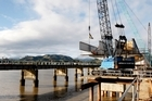 Cranes lifting a steel truss onto the far side of the bridge.Photo / Christine Cornege.