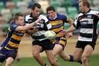 Luke Rooney tries to get a pass away to Jason Shoemark. Photo / APN