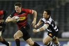 Colin Slade of Canterbury breaks through the tackle of Karl Lowe of Hawkes Bay. Photo / Getty Images
