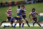 Tana Umaga is tackled by Glenn Dickson of Otago. Photo / Getty Images
