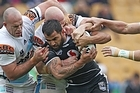 Aaron Heremaia of the Warriors is caught by Luke Bailey of the Titans. Photo / Getty Images