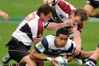 Atieli Pakalani of Auckland is tackled by Scott Uren (L) and Tom Chamberlain of North Harbour. Photo / Getty Images
