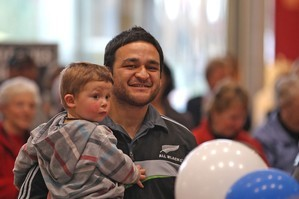 All Black Piri Weepu makes young supporter Eli Stoddart's day at a Christchurch mall yesterday. Photo / Getty Images