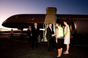 Prime Minister John Key is greeted by deputy high commissioner Suzannah Jessep (right) and chief of protocol Elena Haines on his arrival in Vanuatu. Photo / Mark Mitchell