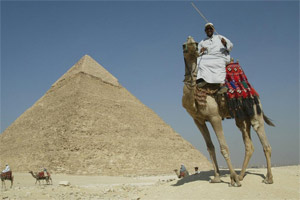 A camel driver touts for business at the great pyramids of Giza near Cairo. Photo / Alan Gibson