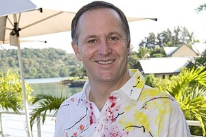 PM John Key, wearing his Vanuatu shirt, before leaving for the Pacific Islands Forum Leaders retreat at the Havannah Resort. Photo / Mark Mitchell