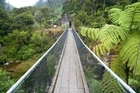 Swing bridge forming part of the walkway in the Karangahake Gorge. Photo / Jim Eagles