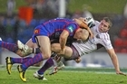 Adam MacDougall of the Knights tackles Kieran Foran of the Eagles. Photo / Getty Images
