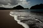 Whatipu Beach at the entrance of Manukau Harbour. Photo / Brett Phibbs