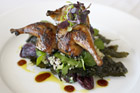 Mikano's honey-roasted quail entree was superb, but suffered in the dim light. Photo / Steven McNicholl
