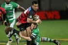 Tu Umaga-Marshall of Canterbury is tackled by Hadleigh Parkes of Manawatu. Photo / Getty Images