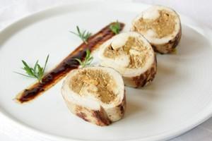 Date, lemon, feta & pinenut-stuffed chicken. Photo / Ian Jones