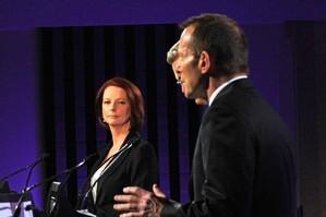 Australian Prime Minister Julia Gillard (l), with Opposition Leader Tony Abbott. Photo / Getty Images