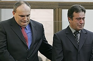 Brad Shipton comforts Bob Schollum during their sentencing in 2005. Photo / Mark Mitchell