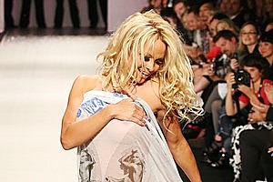 Pamela Anderson walked down A*Muse's runway show with only a scarf, giving last year's Fashion Week a fabulously flirty edge. Photo / Babiche Martens