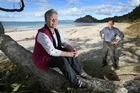Linda Cholmondeley-Smith (L) and Peter Johnston, of Ngati Hei, pictured under the pohutukawa trees on New Chums Beach. Photo / Alan Gibson