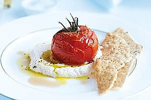 Roasted tomatoes with goat's curd. Photo / Chris Court