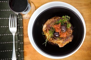 Lamb neck with olives and orange. Photo / Babiche Martens