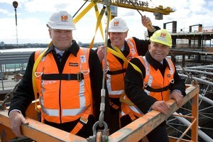 Chris Hunter (centre) with Matthew Cockram and  Rodney Hide on top of the East building at Britomart. Photo / Supplied
