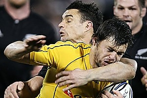 Adam Ashley-Cooper of the Wallabies is hit hard by All Black Dan Carter during Saturday's Bledisloe Cup game. Photo / Getty Images