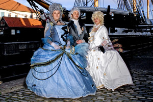 Women in Georgian costume with the HMS Trincomalee. Photo / Chris Armstrong
