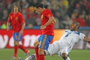 Honduras player Wilson Palacios tackles Spain's Xavi during their World Cup pool match. Photo / Brett Phibbs